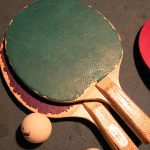 table tennis racket with ping pong balls