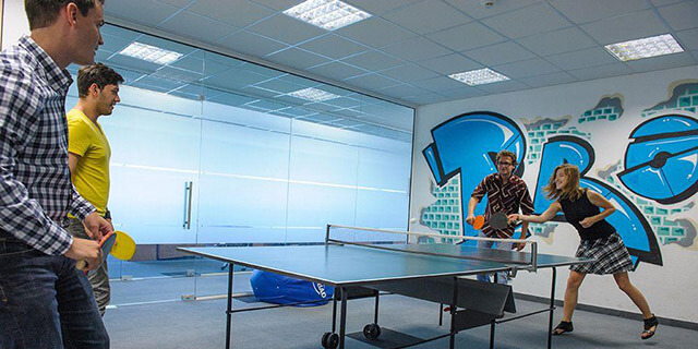 4 Young People Playing Ping Pong